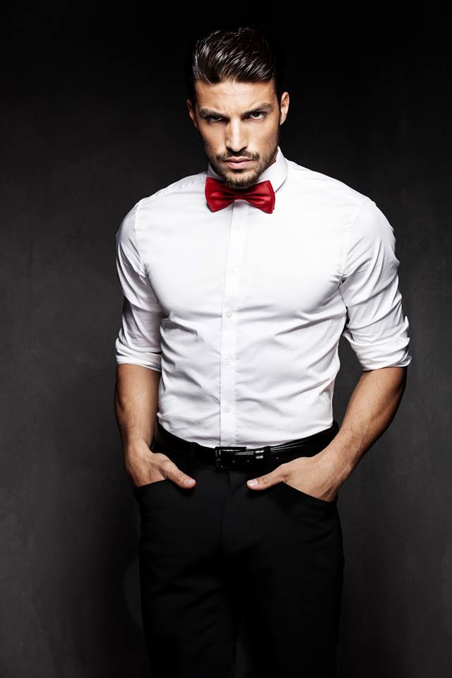 Black shirt red tie vest